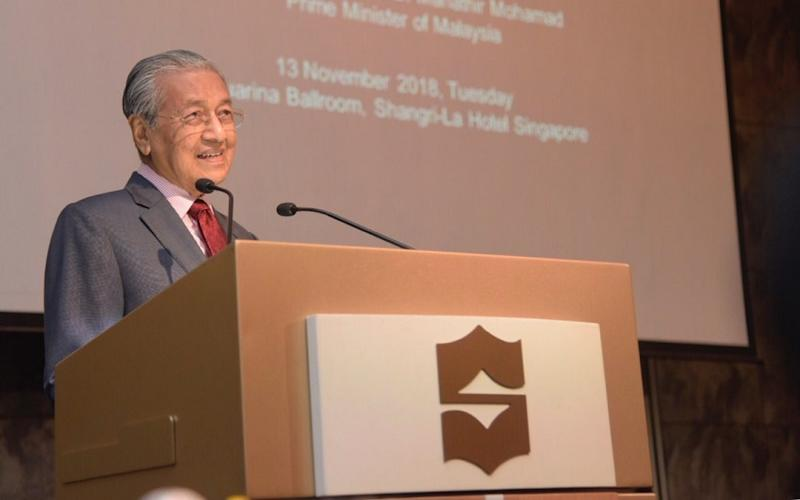 Tun Dr Mahathir Mohamad is keen on building more road links between Malaysia and Singapore. — Picture courtesy of the Information Department of Malaysia