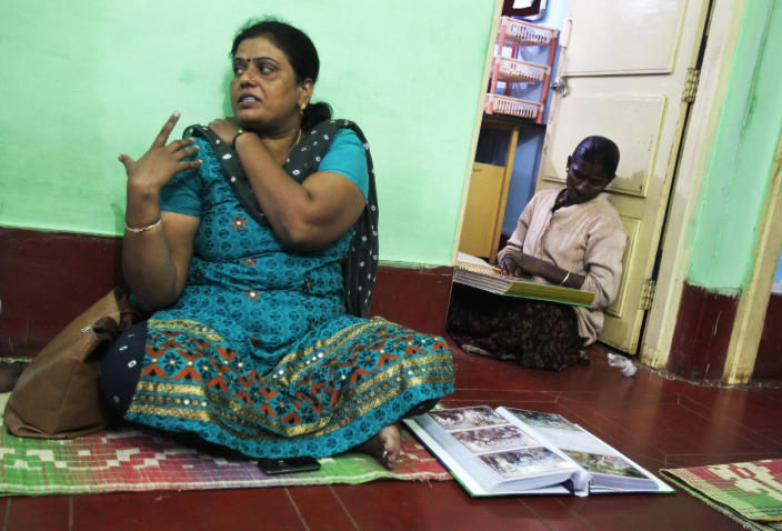 In this Dec. 4, 2012 photo, Yashoda Puttappa, left, a land rights activist, speaks to The Associated Press at her office in Anekal 40 kilometers (25 miles) from Bangalore in the southern Indian state of Karnataka. For years, Karnataka's land records were a quagmire of disputed, forged documents maintained by thousands of tyrannical bureaucrats who demanded bribes to do their jobs. In 2002, there were hopes that this was about to change. (AP Photo/Aijaz Rahi)