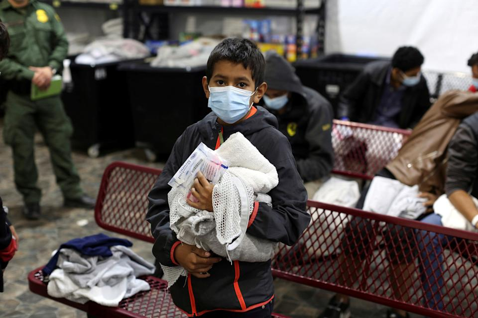 A young migrant boy waits for his turn to take a shower at the Department of Homeland Security holding facility in Donna, Texas on March 30, 2021. (Dario Lopez-Mills/Pool via Reuters)