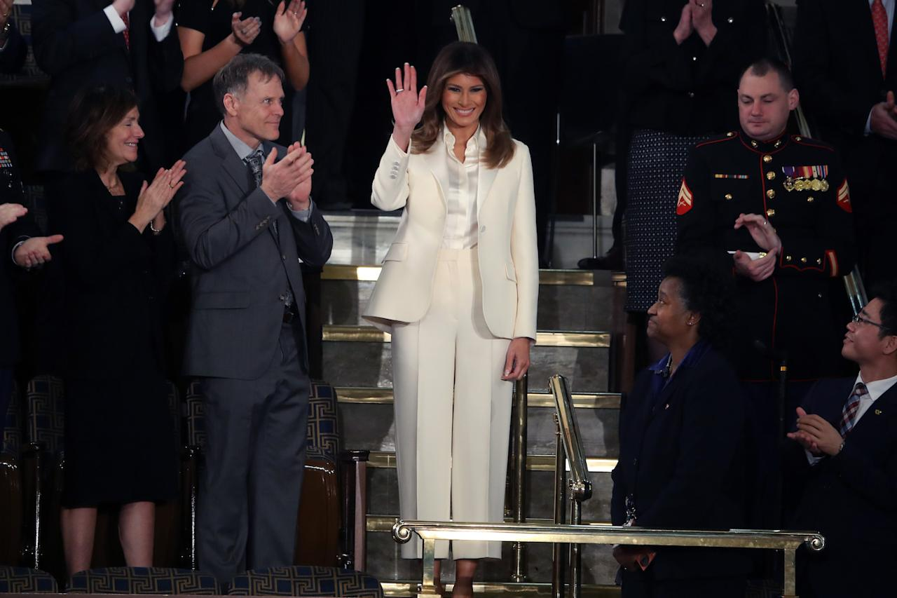 "<p>The first lady arrived for the State of the Union address in an outfit reminiscent of former FLOTUS and presidential candidate Hillary Clinton. The <a rel=""nofollow"" href=""https://www.yahoo.com/lifestyle/melania-trump-wears-white-suffragette-suit-state-union-address-024420487.html"">cream-colored Christian Dior pantsuit</a> was also evocative of the Suffragettes. (Photo: Getty Images) </p>"