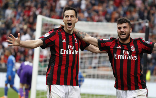 AC Milan's Nikola Kalinic, left, celebrates with his teammate Patrick Cutrone after scoring his side's third goal during the Serie A soccer match between AC Milan and Fiorentina at the San Siro stadium in Milan, Italy, Sunday, May 20, 2018. (AP Photo/Antonio Calanni)
