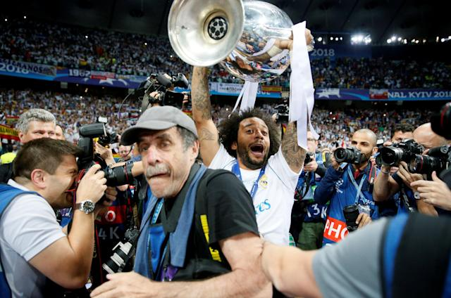 Soccer Football - Champions League Final - Real Madrid v Liverpool - NSC Olympic Stadium, Kiev, Ukraine - May 26, 2018 Real Madrid's Marcelo celebrates with the trophy after winning the Champions League REUTERS/Gleb Garanich