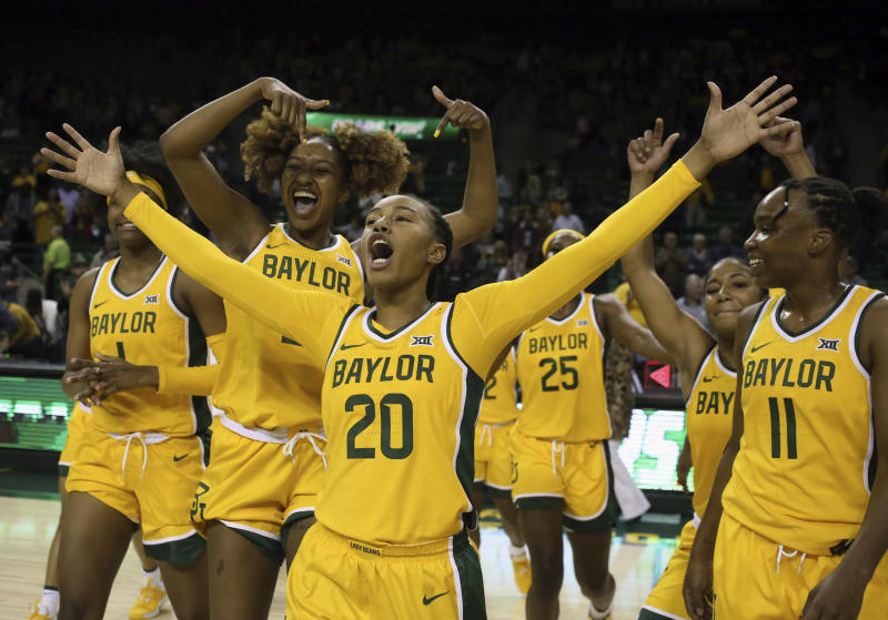 Baylor guard Juicy Landrum (20) reacts after their win over Arkansas State following an NCAA college basketball game, Wednesday, Dec. 18, 2019, in Waco, Texas. Landrum had 14, 3-point plays in the game. (Rod Aydelotte/Waco Tribune Herald, via AP)/Waco Tribune-Herald via AP)