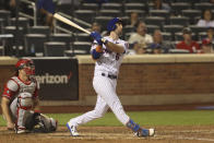New York Mets' Jeff McNeil hits a home run during the seventh inning of a baseball game against the Philadelphia Phillies, Sunday, Sept. 19, 2021, in New York. (AP Photo/Jason DeCrow)
