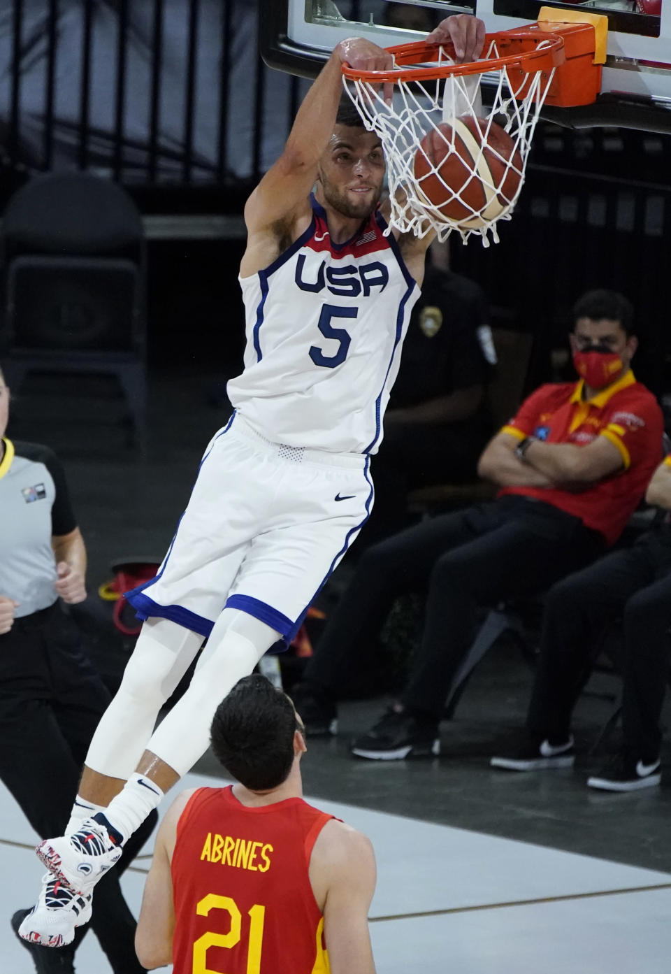 United States' Zach Lavine (5) dunks against Spain's Alex Abrines (21) during the second half of an exhibition basketball game in preparation for the Olympics, Sunday, July 18, 2021, in Las Vegas. (AP Photo/John Locher)