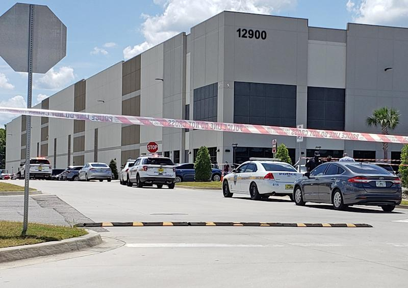 This was the scene on June 29 when a gunman killed someone outside the Amazon fulfillment center on Pecan Park Road. Police are reported back at the center Tuesday night. [Dan Scanlan/Florida Times-Union]