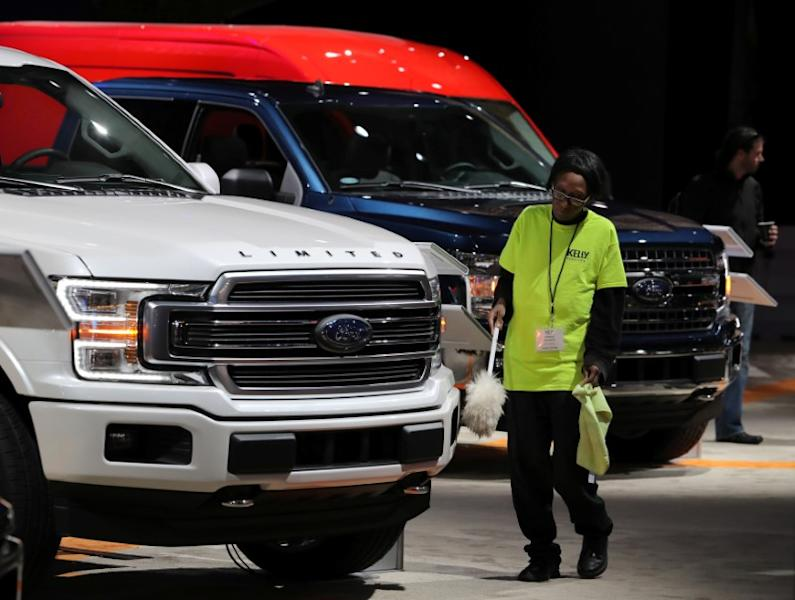 FILE PHOTO: FILE PHOTO: A worker cleans Ford pickup truck at the North American International Auto Show in Detroit, Michigan