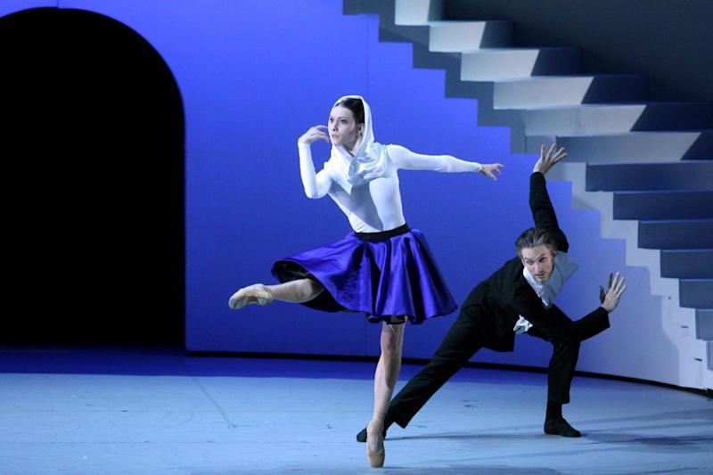 """Russian ballet dancers Olga Smirnova and Artemy Belyakov (R) performing during the premiere of """"The Taming of the Shrew"""" on July 4, 2014 at Moscow's Bolshoi"""