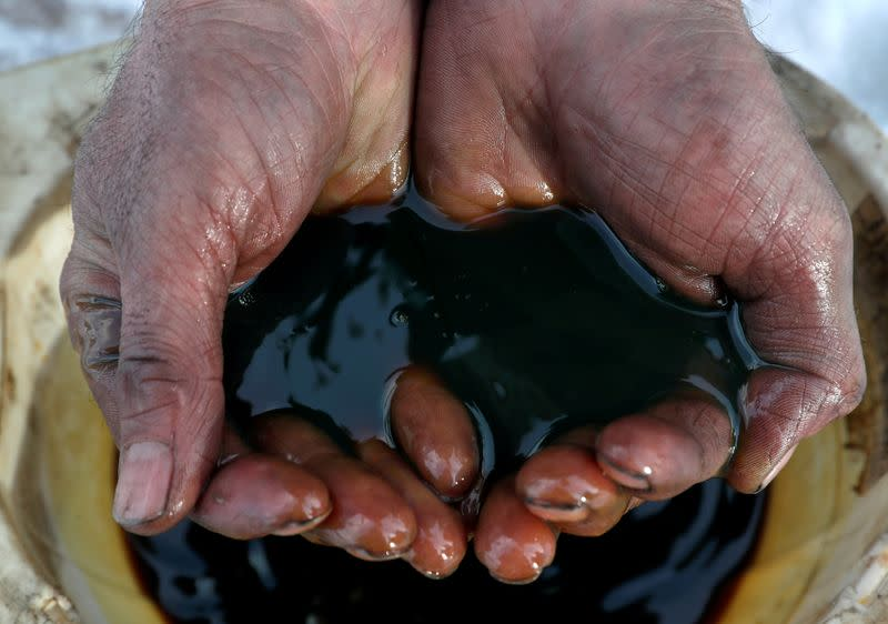 Oil prices fall on oversupply worries as virus hits China demand