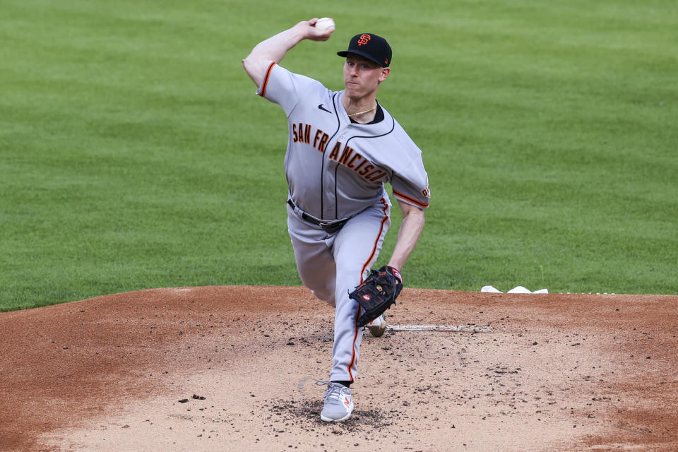 San Francisco Giants' Anthony DeSclafani throws during the first inning of the team's baseball game against the Cincinnati Reds in Cincinnati, Tuesday, May 18, 2021. (AP Photo/Aaron Doster)