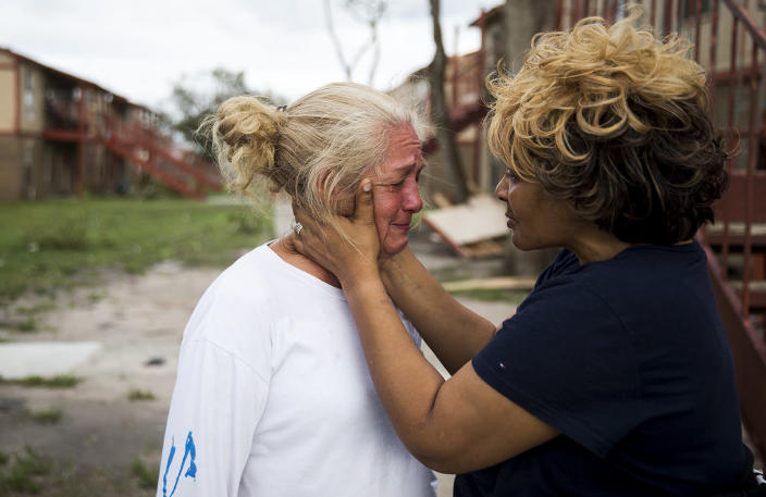 """<p>Genice Gipson comforts her lifelong friend, Loretta Capistran, outside of Capistran's apartment complex in Refugio, Texas, on Monday, Aug. 28, 2017. """"We got to be strong, baby,"""" Gipson told Capistran. (Photo: Nick Wagner/Austin American-Statesman via AP) </p>"""