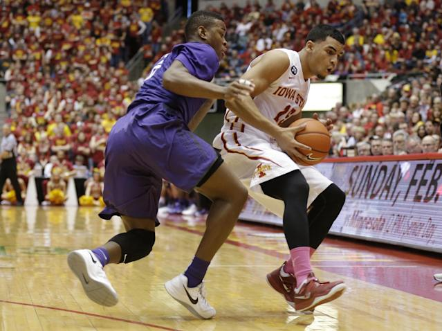 Iowa State guard Naz Long, right, catches a pass in front of Kansas State guard Marcus Foster, left, during the first half of an NCAA college basketball game, Saturday, Jan. 25, 2014, in Ames, Iowa. (AP Photo/Charlie Neibergall)