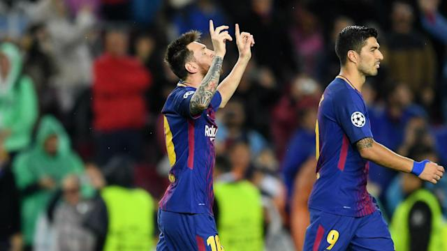 Barcelona were not made to pay for Gerard Pique's needless red card as Lionel Messi scored his 100th European goal against Olympiacos.