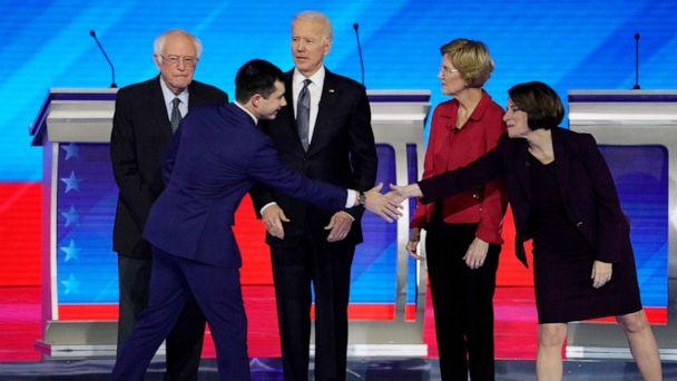PHOTO: Pete Buttigieg shakes hands with Sen. Amy Klobuchar as Sen. Bernie Sanders, former Vice President Joe Biden and Sen. Elizabeth Warren look on at the Democratic 2020 presidential debate at Saint Anselm College in Manchester, N.H., Feb. 7, 2020. (Brian Snyder/Reuters)