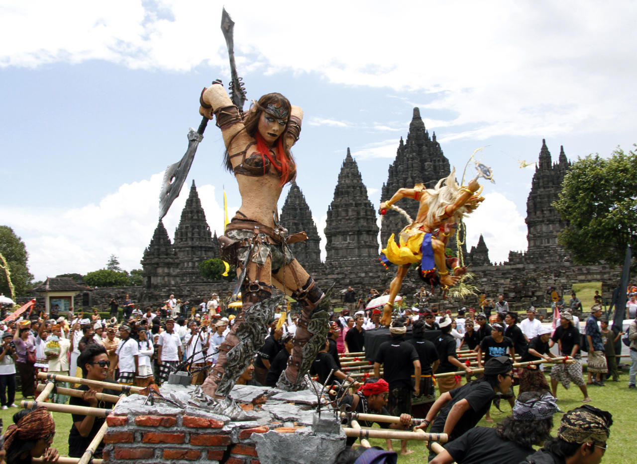 Worshippers carry a giant effigy called 'ogoh-ogoh' that represents evil spirits during a parade a day before Nyepi, the annual day of silence marking the Balinese Hindu New Year at 9th century Prambanan temple in Yogyakarta, Indonesia, Thursday, March 22, 2012. Hindus in the world's most populous Muslim country will celebrate their new year Friday by observing a day of silence in which they have to stay inside their homes and meditate in silence and darkness for the entire day. (AP Photo/A.K. Hendratmo)