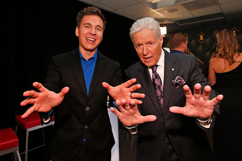 "Alex Trebek poses with ""Jeopardy!"" champion James Holzhauer, who will compete in a 'Greatest of All Time' tournament airing in January, backstage at the 2019 NHL Awards last June in Las Vegas."
