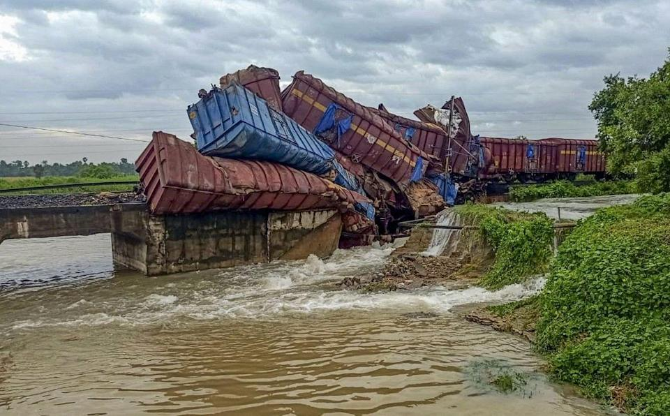 """<div class=""""paragraphs""""><p>Angul: Coaches of a goods train that derailed after a bridge collapse on Talcher- Angul railway section following heavy rains, in Angul district on Tuesday, 14 September.</p></div>"""