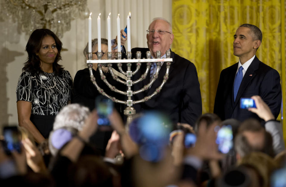 <p>To ring in the Jewish holiday, Michelle Obama wore an electric blouse — quite literally — with a lighting pattern on it. <i>Photo: AP</i></p>