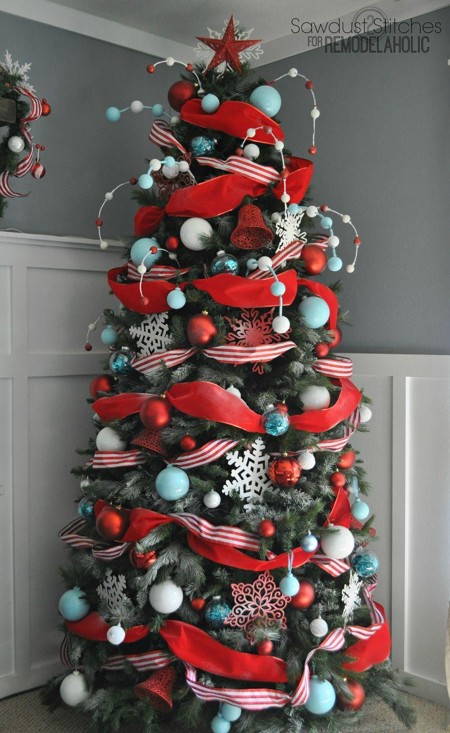 "<p>Combine a solid and striped ribbon when wrapping a skinnier tree to give it a fuller look. </p><p>See more at <a href=""http://www.remodelaholic.com/decorate-christmas-tree-designer-dollar-store/"" rel=""nofollow noopener"" target=""_blank"" data-ylk=""slk:Remodelaholic"" class=""link rapid-noclick-resp"">Remodelaholic</a>.</p><p><a class=""link rapid-noclick-resp"" href=""https://www.amazon.com/Berwick-Velvet-Ribbon-2-Inch-10-Yard/dp/B0091CHW0E/?tag=syn-yahoo-20&ascsubtag=%5Bartid%7C10057.g.505%5Bsrc%7Cyahoo-us"" rel=""nofollow noopener"" target=""_blank"" data-ylk=""slk:SHOP RIBBON"">SHOP RIBBON</a> <em><strong>Red Ribbon, $12</strong></em></p>"