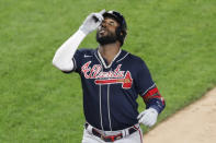 Atlanta Braves Marcell Ozuna reacts crossing the plate after hitting a three-run, home run during a baseball game against the New York Yankees, Tuesday, Aug. 11, 2020, in New York. (AP Photo/Kathy Willens)