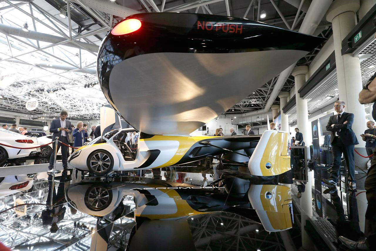 <p>AeroMobil display their latest prototype of a flying car, in Monaco, Thursday, April 20, 2017. The light frame plane whose wings can fold back, like an insect is boosted by a rear propeller. The company says it is planning to accept first preorders for the vehicle as soon as later this year. (AP Photo/Claude Paris) </p>