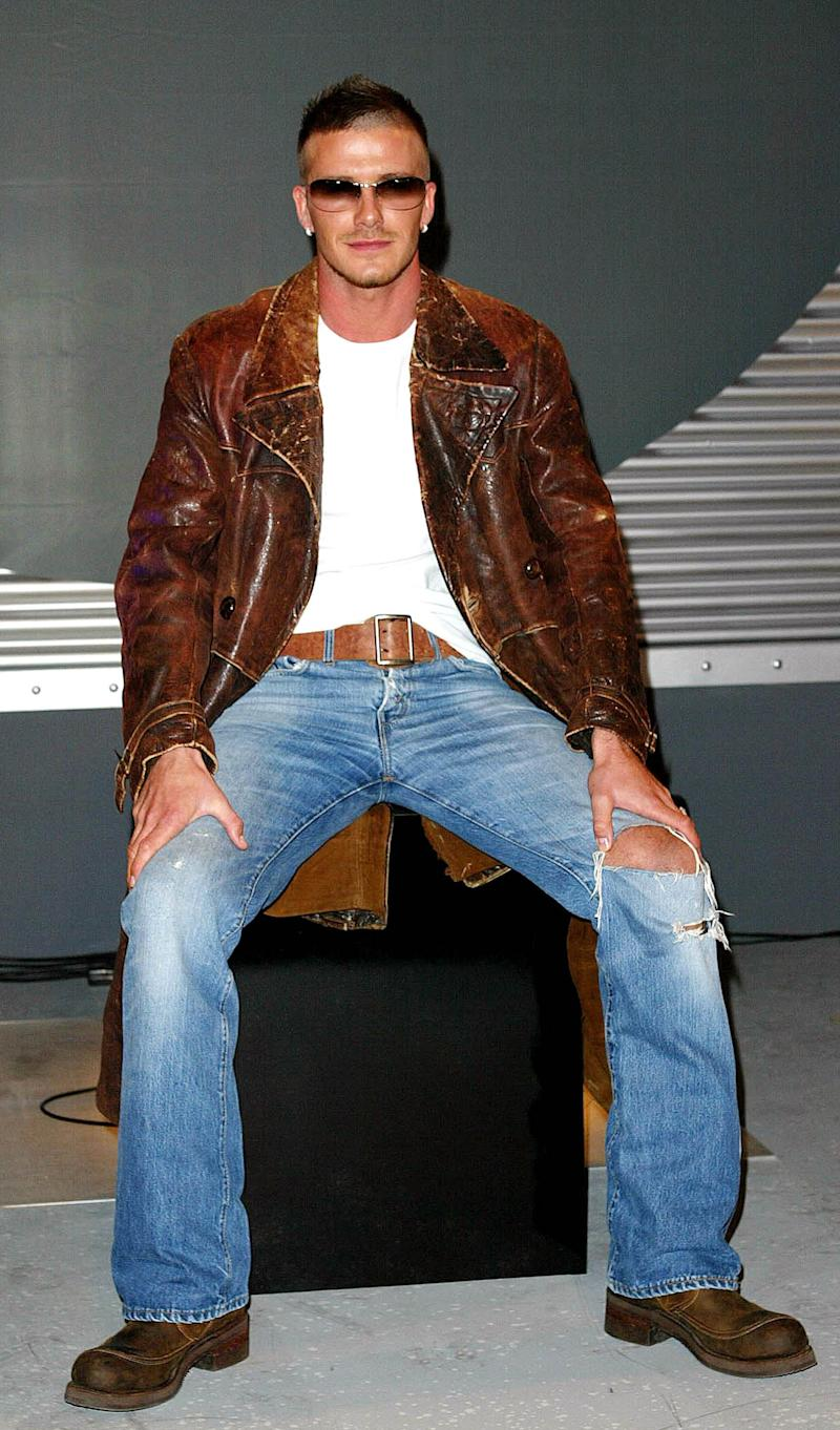 Launching a range of Police sunglasses in February 2002 in London. Beckham wears a battered leather jacket, large belt, ripped jeans and... that pose.
