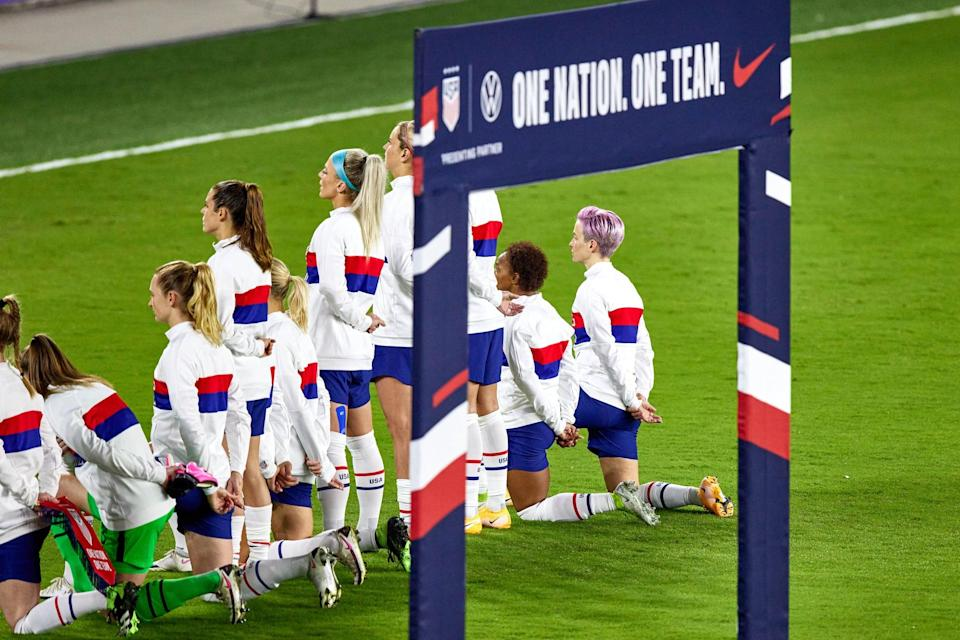 """<p>Beyond her support for equal pay, Rapinoe has been a forceful advocate for racial justice throughout her career. An early supporter of Colin Kaepernick, Rapinoe knelt for the national anthem during a USWNT game in 2016 and faced immediate criticism for it.</p> <p>""""I think it's actually pretty disgusting the way [Kaepernick] was treated . . . We need to <a href=""""http://americansoccernow.com/articles/megan-rapinoe-kneels-for-anthem-at-nwsl-match"""" class=""""link rapid-noclick-resp"""" rel=""""nofollow noopener"""" target=""""_blank"""" data-ylk=""""slk:have a more thoughtful, two-sided conversation"""">have a more thoughtful, two-sided conversation</a> about racial issues in this country,"""" she told <strong>American Soccer Now</strong> at the time. As a gay American, she continued, """"I know what it means to look at the flag and not have it protect all of your liberties. It was something small that I could do and something that I plan to keep doing in the future and hopefully spark some meaningful conversation around it. It's important to have white people stand in support of people of color on this.""""</p> <p>In 2017, US Soccer banned players from kneeling during the national anthem. Rapinoe was left off the national team roster for over six months after she knelt during the anthem, thought coach Jill Ellis said it was performance-related. US Soccer ultimately <a href=""""https://www.popsugar.com/fitness/uswnt-wants-us-soccer-anthem-policy-repealed-47537167"""" class=""""link rapid-noclick-resp"""" rel=""""nofollow noopener"""" target=""""_blank"""" data-ylk=""""slk:repealed the rule in 2021"""">repealed the rule in 2021</a>.</p>"""