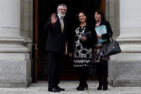 FILE PHOTO - Sinn Fein President Gerry Adams, Deputy leader Mary Lou McDonald and Michelle Gildernew wave on the steps of Government buildings ahead of a meeting with Prime Minister of Ireland Leo Varadkar in Dublin, Ireland June 16, 2017. REUTERS/Clodagh Kilcoyne