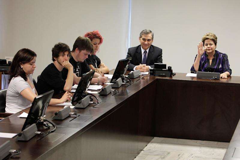 FILE - June 24, 2013 Brazil's President Dilma Rousseff, right, accompanied by Gilberto Carvalho, secretary-general of the presidency of Brazil, second right, attend a meeting with representatives of the Free Fare Movement, left, the group that ignited the original protests in Sao Paulo against a hike in public transport fares, at the Presidential Palace, in Brasilia, Brazil. The Free Fare Movement, which advocates for the elimination of all transit fees, didn't expect to become the focal point of what some Brazilian media are calling the most important mass demonstrations in the nation's history. Nor did they imagine they'd be tapped as one of the few groups, if not the only one, to decide whether the protests grow or fade away in the coming days and weeks. (AP Photo/Eraldo Peres, File)