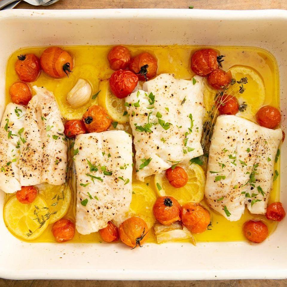 """<p>The best thing about cod is that it is a bit of a blank slate and can be seasoned/flavoured however you want. In this dish, we pair it with tomatoes and fresh thyme, but it could just as well with smashed olives and oregano. </p><p>Get the <a href=""""https://www.delish.com/uk/cooking/recipes/a29733946/best-baked-cod-fish-recipe/"""" rel=""""nofollow noopener"""" target=""""_blank"""" data-ylk=""""slk:Perfect Baked Cod"""" class=""""link rapid-noclick-resp"""">Perfect Baked Cod</a> recipe.</p>"""