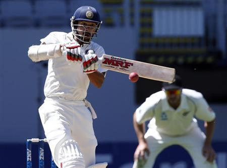 Shikhar Dhawan plays a pull shot while scoring a century during his second innings on day four of the first international test cricket match against New Zealand at Eden Park in Auckland, February 9, 2014. REUTERS/Nigel Marple