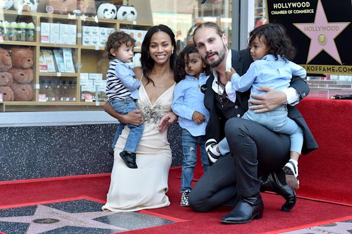 Saldana with her husband Marco Perego and their three sons as she received a star on the Hollywood Walk of Fame in 2018.