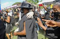 The widow of slain Haitian president Jovenel Moise, Martine (C), wore a mask bearing his photo at his funeral