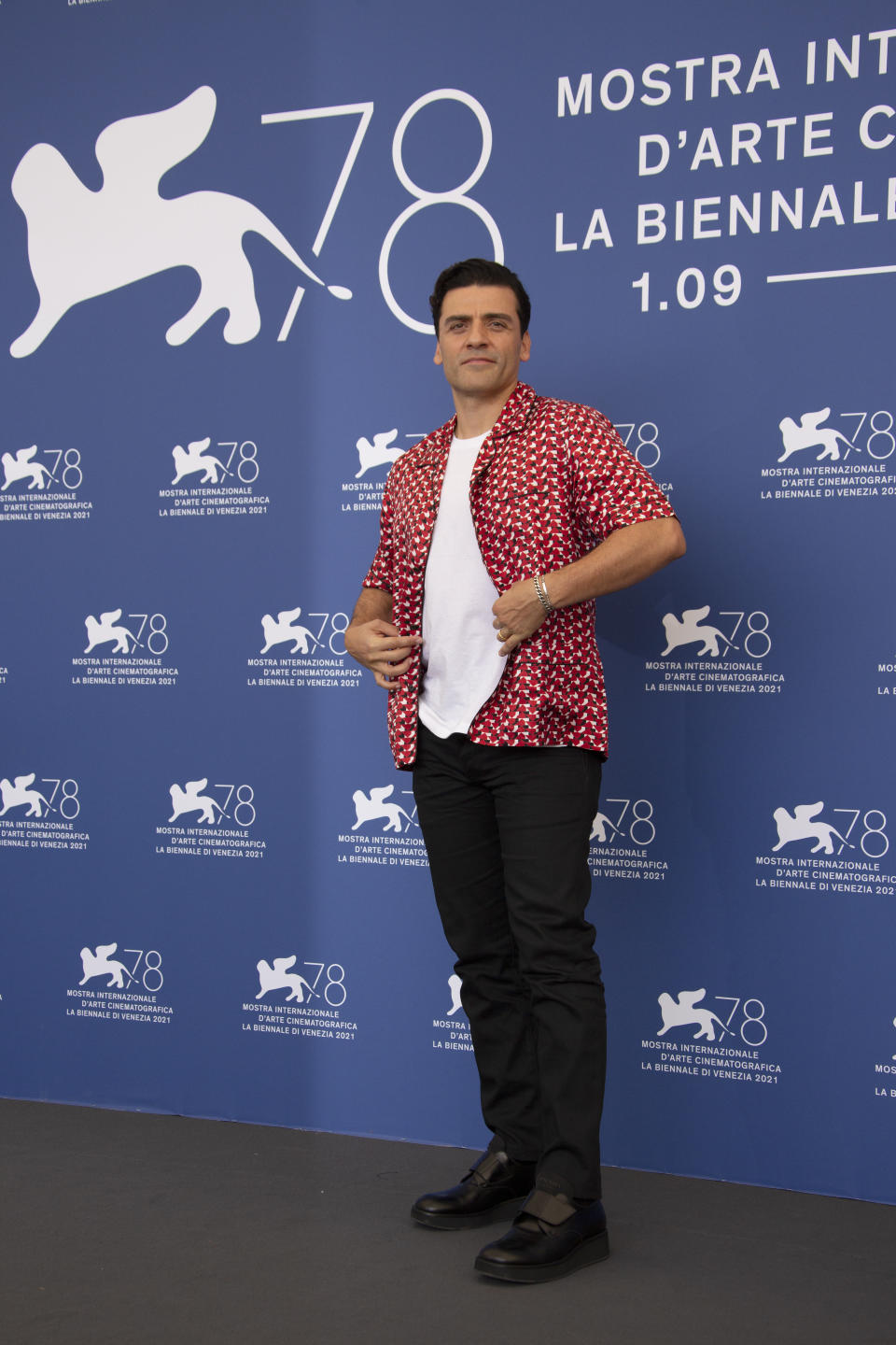 Oscar Isaac poses for photographers at the photo call for the film 'Scenes of a Marriage' during the 78th edition of the Venice Film Festival in Venice, Italy, Saturday, Sep, 4, 2021. (Photo by Joel C Ryan/Invision/AP)