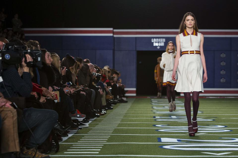 A model presents a creation from the Tommy Hilfiger Fall/Winter 2015 Collection at the New York Fashion Week February 16, 2015. Shunning the traditional catwalk, Mr. Hilfiger instead presented his collection on a mock American Football field. REUTERS/Andrew Kelly (UNITED STATES - Tags: FASHION)
