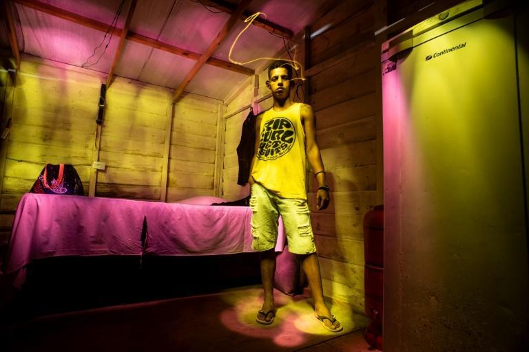 Juraci Andrade dos Santos, who lost his job as a barber when the pandemic started, stands in his house in a squatter camp near Salvador, Brazil