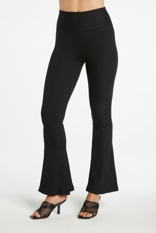 "<p>Year of Ours Ribbed Flare Leggings, $110,<a href=""https://yearofours.com/collections/leggings/products/ribbed-flare-legging?variant=32405180088375"" rel=""nofollow noopener"" target=""_blank"" data-ylk=""slk:available here"" class=""link rapid-noclick-resp""> available here</a> (sizes XS-XL). </p>"