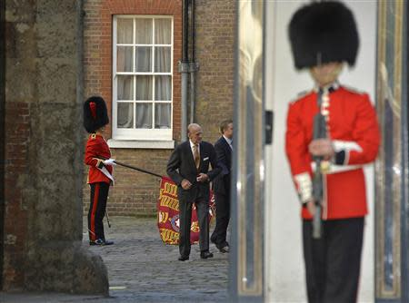 Britain's Prince Philip arrives for the christening of Prince George at St James's Palace in London October 23, 2013. REUTERS/Toby Melville