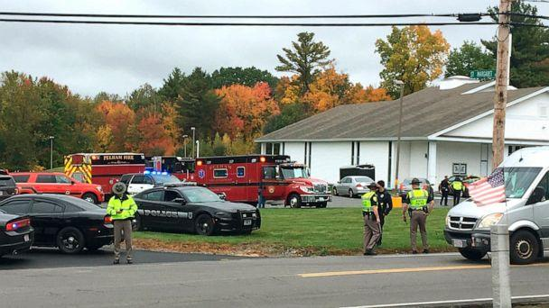 PHOTO: In this photo provided by WMUR-TV, police stand outside the New England Pentecostal Church after reports of a shooting on Oct. 12, 2019, in Pelham, N.H. (Siobhan Lopez/WMUR-TV via AP)