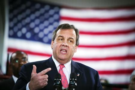 New Jersey Governor Chris Christie gestures as he speaks to media and homeowners about the ongoing recovery from Hurricane Sandy in Manahawkin, New Jersey