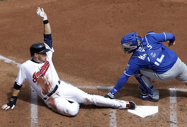 Cleveland Indians' Asdrubal Cabrera, left, is tagged out at the plate by Kansas City Royals catcher Brett Hayes in the first inning of a baseball game Thursday, April 24, 2014, in Cleveland. The call was upheld after a crew challenge. (AP Photo/Mark Duncan)
