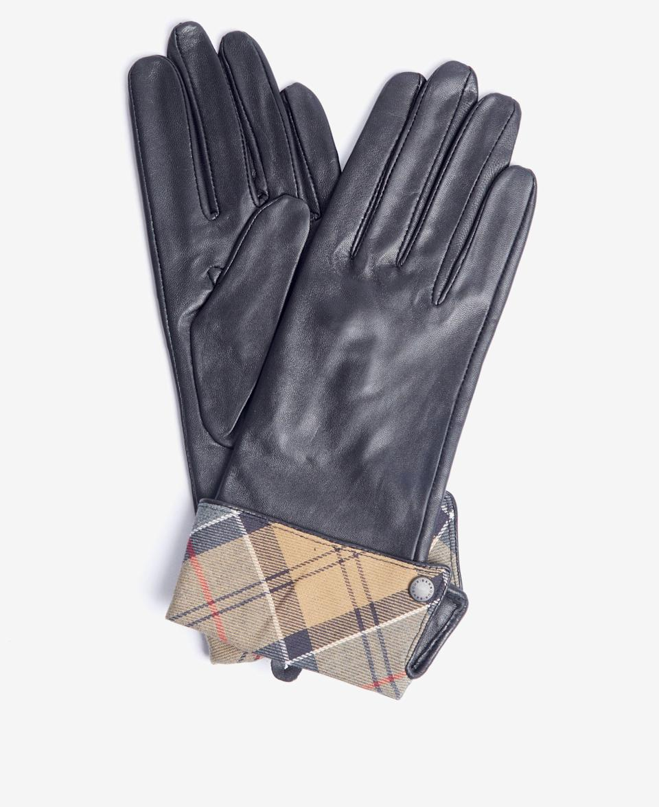 """<p><strong>Barbour</strong></p><p>nordstrom.com</p><p><strong>$80.00</strong></p><p><a href=""""https://go.redirectingat.com?id=74968X1596630&url=https%3A%2F%2Fwww.nordstrom.com%2Fs%2Fbarbour-lady-jane-tartan-cuff-leather-gloves%2F5737743&sref=https%3A%2F%2Fwww.cosmopolitan.com%2Fstyle-beauty%2Ffashion%2Fg37871219%2Fbest-womens-leather-gloves%2F"""" rel=""""nofollow noopener"""" target=""""_blank"""" data-ylk=""""slk:Shop Now"""" class=""""link rapid-noclick-resp"""">Shop Now</a></p><p>These vintage-style leather gloves feature a soft fleece lining and cool tartan cuffs for a look that's more unique. </p><p><strong>Glowing Review: </strong><em>I was searching high and low for the Burberry version of these, and when I stumbled upon these I had to have them—and at a fraction of the Burberry price! The leather is so soft and they are simply just elegant.</em></p>"""