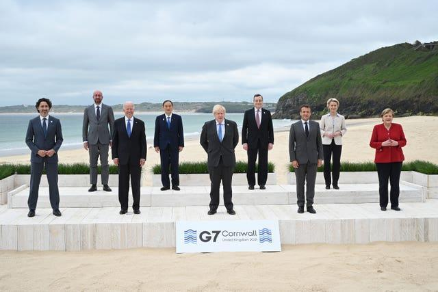 Left to right, Canadian Prime Minister Justin Trudeau, president of the European Council Charles Michel, US President Joe Biden, Japanese Prime Minister Yoshihide Suga, British Prime Minister Boris Johnson, Italian Prime Minister Mario Draghi, French President Emmanuel Macron, president of the European Commission Ursula von der Leyen and German Chancellor Angela Merkel during the leaders' official welcome and family photo in Carbis Bay during the G7 summit in Cornwall
