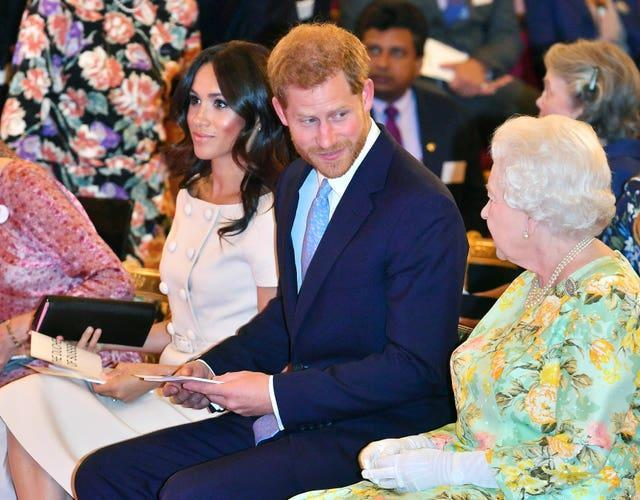 The Sussexes with Harry's grandmother the Queen in 2018