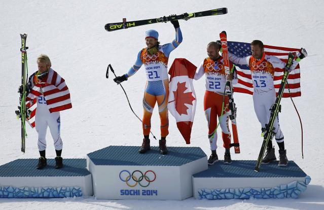 Jansrud celebrates with Weibrecht, Hudec and Miller after the men's alpine skiing Super-G competition at the 2014 Sochi Winter Olympics