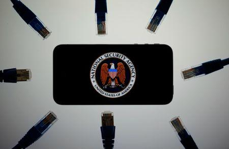 FILE PHOTO: An illustration picture shows the logo of the U.S. National Security Agency on the display of an iPhone