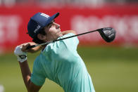 Joaquin Niemann of Chile drives on from the 16th tee during the second round of the Rocket Mortgage Classic golf tournament, Friday, July 2, 2021, at the Detroit Golf Club in Detroit. (AP Photo/Carlos Osorio)