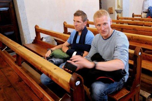 "Danish mountaineer Thomas Dybro (R) and his friend Alex Peterson, both survivors from an avalanche in the French Alps, attend an ecumenical prayer to pay tribute to the nine victims at the Saint-Michel church. The avalanche swept away a group of European climbers on July 12, killing nine people on the slopes of Mont Maudit, or ""Cursed Mountain"" in English. AFP PHOTO / JEAN-PIERRE CLATOT"