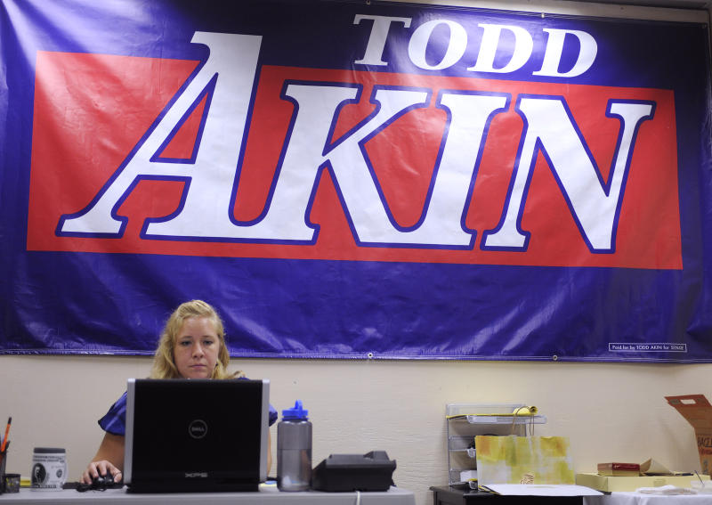 "Alaina Carnan of Lexington, Ky., works in the Senate campaign office of U.S. Rep. Todd Akin, R-Mo., Tuesday, Aug. 21, 2012 in Chesterfield, Mo. Akin has come under pressure to abandon his Senate compaign after his comments that women's bodies can prevent pregnancies in cases of ""legitimate rape"". (AP Photo/Bill Boyce)"