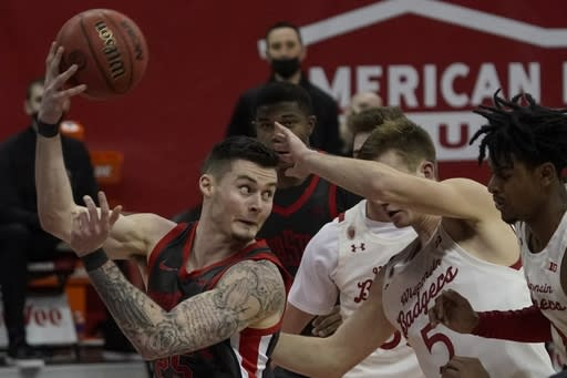 Ohio State's Kyle Young saves the ball from going out of bounds during the second half of an NCAA college basketball game against WisconsinSaturday, Jan. 23, 2021, in Madison, Wis. (AP Photo/Morry Gash)